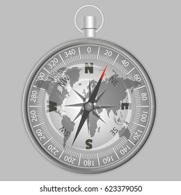silver compass on a world map indicating the direction to the North-East