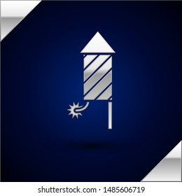 Silver Firework rocket icon isolated on dark blue background. Concept of fun party. Explosive pyrotechnic symbol.  Vector Illustration