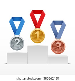 Silver, gold, bronze medals on podium