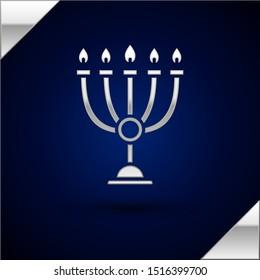 Silver Hanukkah menorah icon isolated on dark blue background. Hanukkah traditional symbol. Holiday religion, jewish festival of Lights.  Vector Illustration