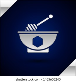 Silver Honey dipper stick and bowl icon isolated on dark blue background. Honey ladle.  Vector Illustration