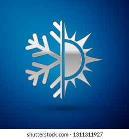 Silver Hot and cold symbol. Sun and snowflake icon isolated on blue background. Winter and summer symbol. Vector Illustration