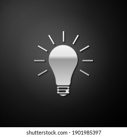Silver Light bulb with rays shine icon isolated on black background. Energy and idea symbol. Lamp electric. Long shadow style. Vector.
