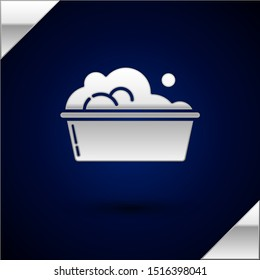 Silver Plastic basin with soap suds icon isolated on dark blue background. Bowl with water. Washing clothes, cleaning equipment.  Vector Illustration