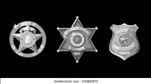 Silver police and sheriff badges on black background