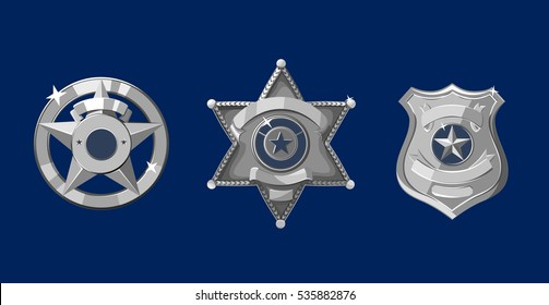 Silver police and sheriff badges on dark blue background