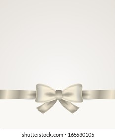 silver ribbon and bow with bow on silver background