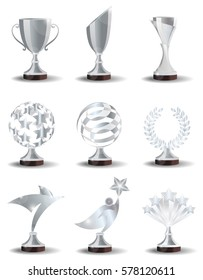 Silver Trophy Cups and Awards  in the form of  abstract shapes with the stars and lines, Laurel wreath, bird and Superman. Realistic vector set, illustration isolated on white background