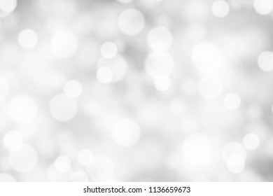 Silver and white bokeh background, texture or backdrop