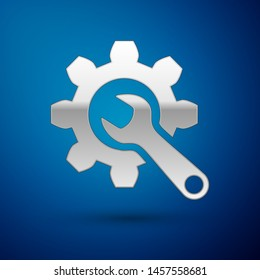 Silver Wrench and gear icon isolated on blue background. Adjusting, service, setting, maintenance, repair, fixing.  Vector Illustration