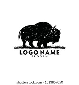 Simple Bison logo vector icon. buffalo bull fight with grass field Silhouette art classic modern look. For cool shirt cloth apparel graphic, game, smart phone app brand. Quiet friendly group gathering