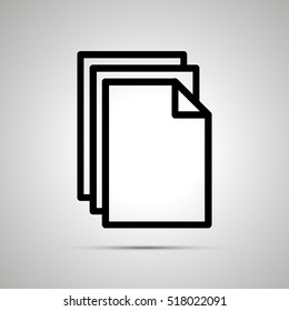 Simple black icon of pile of documents with shadow on light background