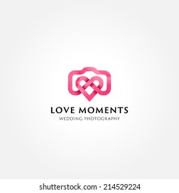 Simple creative wedding photographer symbol, icon, logo consisting of camera and heart