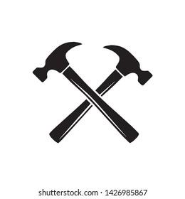 Simple crossed hammers vector symbol
