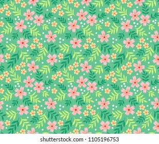 Simple cute pattern in small pink flowers on light green background. Liberty style. Ditsy print. Floral seamless background. The elegant the template for fashion prints.