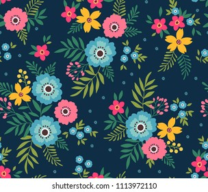 Simple cute pattern in small pink and blue flowers on dark blue background. Liberty style. Ditsy print. Floral seamless background. The elegant the template for fashion prints.