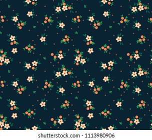 Simple cute pattern in small white and orange flowers on dark blue background. Liberty style. Ditsy print. Floral seamless background. The elegant the template for fashion prints.
