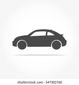 simple floating hatchback car icon viewed from the side colored in dark grey with drop shadow