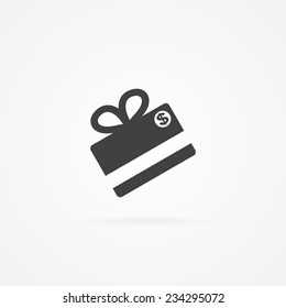 Simple icon of gift made with credit card. Shadow and white background.