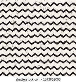 Simple ink zig zag lines geometric seamless pattern. Monochrome black and white strokes background. Hand drawn ink brushed texture for your design