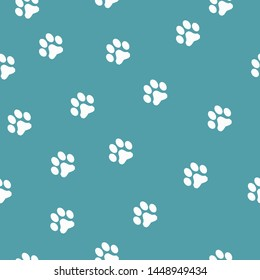 A simple pattern of footprints. Dark blue background, white animal tracks . The print is well suited for textiles,Wallpaper,banners and packaging.