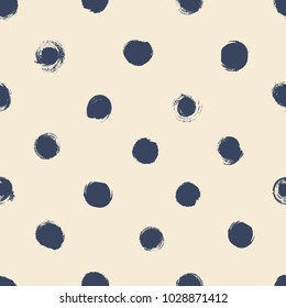 Simple seamless background in polka dots. Hand drawn.