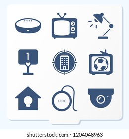 Simple set of 9 icons related to home filled such as desk lamp, building, football game on tv, table, google home, tv, cctv symbols