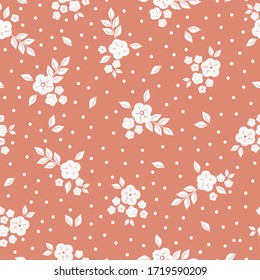 Simple vintage pattern. Pale orange background, white flowers ornament, dots. The print is well suited for textiles, Wallpaper and packaging.