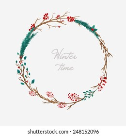 simple winter wreath made of branches and berries