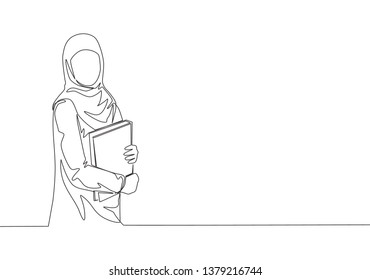 Single continuous line drawing of young female muslim businesswoman carrying annual report books to business meeting. Arab middle east cloth hijab and veil. One line draw design illustration