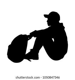 Sitting man with backpack silhouette vector