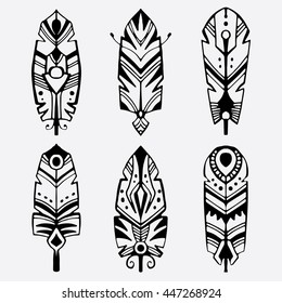 Six decorative bohemian style feathers. Abstract tribal feathers in a tattoo style. Vector illustration