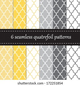 Six seamless geometric patterns with quatrefoil design, in yellow and grey colors