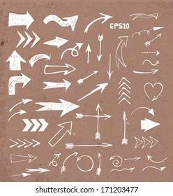 Sketch arrow collection for your design. Hand drawn on brown paper. Vector illustration.