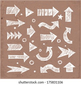 Sketch arrow collection for your design. Hand drawn on brown paper. Vector sketch illustration.