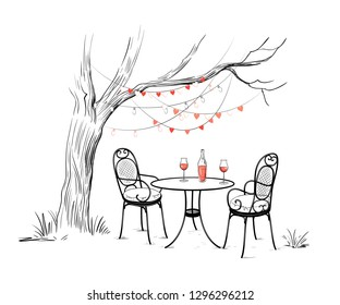 Sketch of the celebration of Valentine's Day outdoors. Tree with garlands of light bulbs and hearts.Two forged chairs with cushions,round table, bottle of rose wine and two glasses. Vector  .