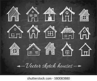 Sketch of houses on blackboard background. Vector illustration.