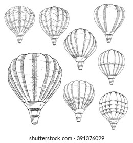 Sketched flying hot air balloons in vintage engraving style with lush envelopes. Air transportation, hobby, romantic weekend, travel design usage