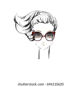 The Sketched Portrait of a Beautiful Girl with Vintage Sunglasses. Vector Sketch of a Beautiful Lady with Cat Eye-Glasses. Fashion Illustration. Beauty Face. Young Lady. Freehand Drawing.