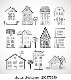 Sketches of houses. Vector illustration. Isolated on white.