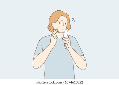 Skin problems, allergy from medical protective mask concept. Young frustrated teen boy cartoon character wearing medical face mask pointing at pimple on chin under mask illustration