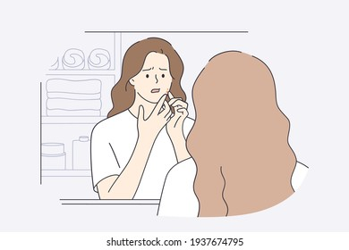 Skincare, skin problems, pimples concept. Beautiful girl in white t-shirt cartoon character squeezing pimples on her face while looking into mirror in bathroom feeling unhappy vector illustration