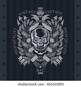 Skull front view with a lower jaw in center oval frame between wreath and cross arrows. Heraldic vintage label on blackboard