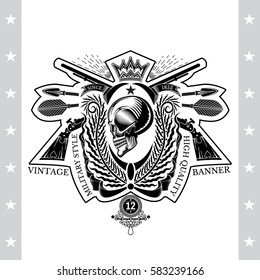 Skull profile view in center of palm wreath with cross rifle and arrows. Heraldic vintage label on white