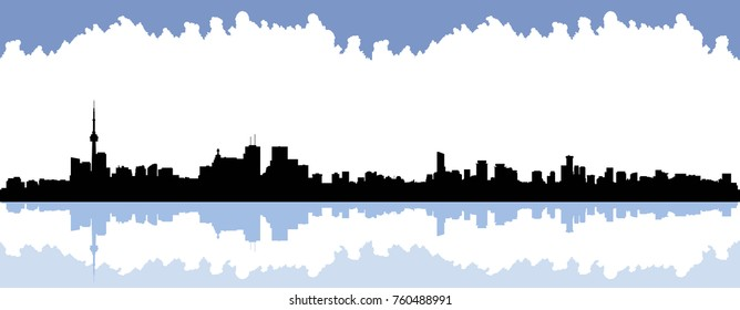 Skyline silhouette of the city of Toronto, Ontario, Canada showing the waterfront view with reflection on the harbour.
