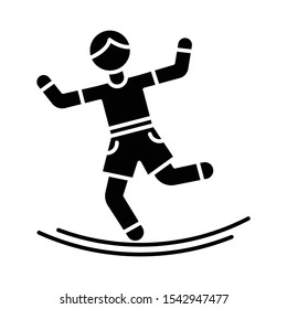 Slacklining glyph icon. Balance training. Slack rope walking. Tightrope walker. Person balancing on suspended webbing. Extreme sport. Silhouette symbol. Negative space. Vector isolated illustration