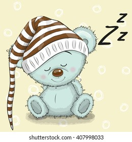 Sleeping cute Teddy Bear in a hood on a white background
