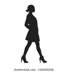Slim woman walking, side view, isolated vector silhouette. Short clothes, high heels shoes, hands in pockets