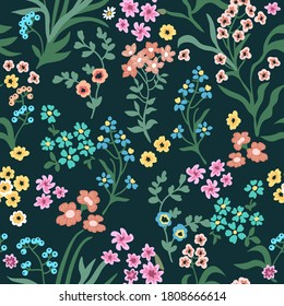 Small autumn flowers on black background. Seamless vector pattern. Vintage print with  inflorescences. Retro textile collection.