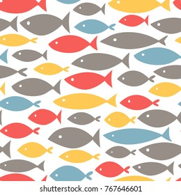 Small colorful fishes on white background. Abstract vector seamless pattern in flat style